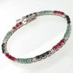 دستبند چند جواهر زنانه یاقوت و زمرد طرح کیهانه