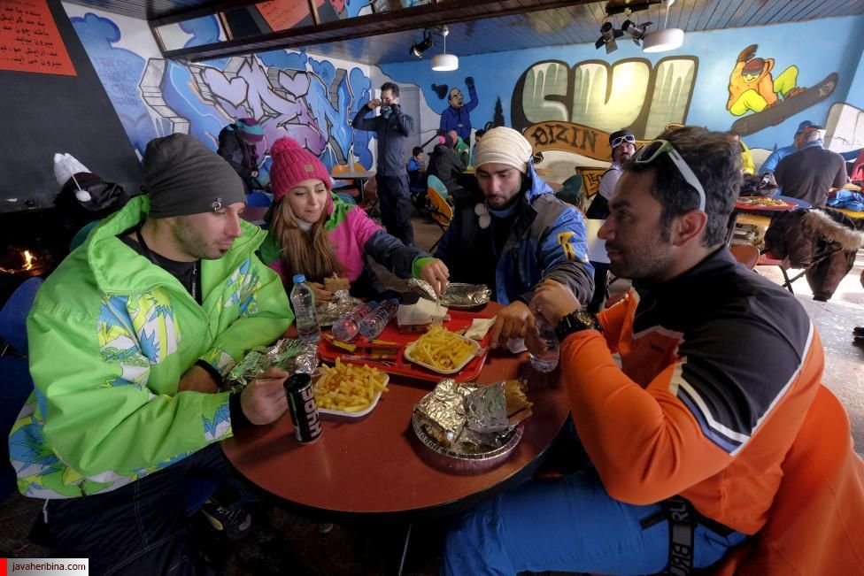 Iranian skiers have meals in a restaurant at the Dizin ski resort, northwest of Tehran