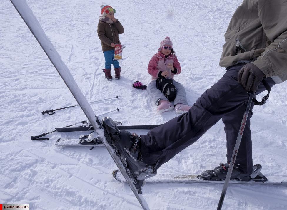 A man trains his children at the Dizin ski resort, northwest of Tehran