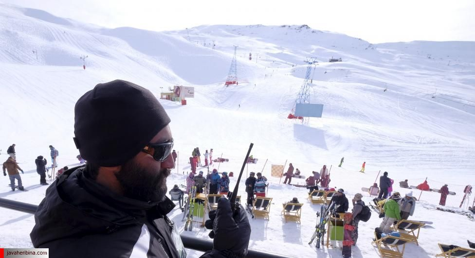 Iranian security man talks on a walkie-talkie at the Dizin ski resort, northwest of Tehran