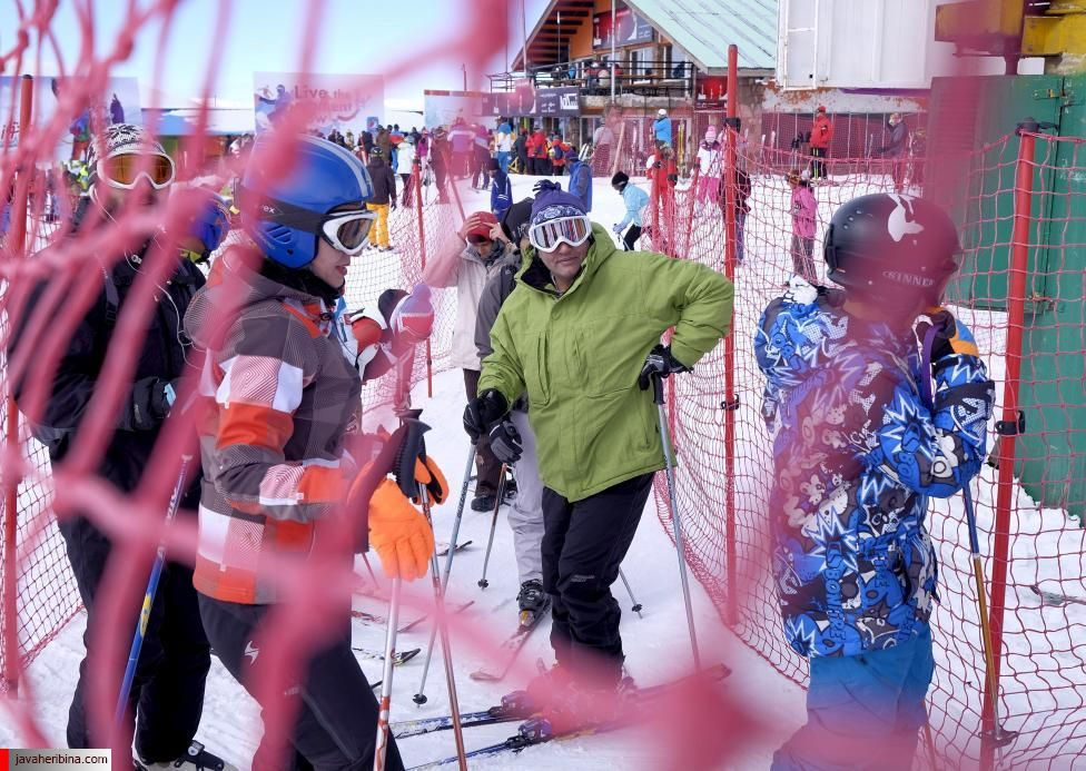 Iranian skiers stand in the cable car queue at the Dizin ski resort, northwest of Tehran